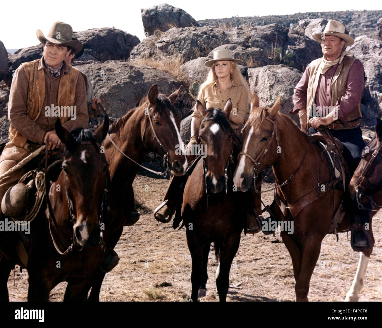 Ben Johnson, Ann-Margret and John Wayne / The Train Robbers / 1973 directed by Burt Kennedy - Stock Image