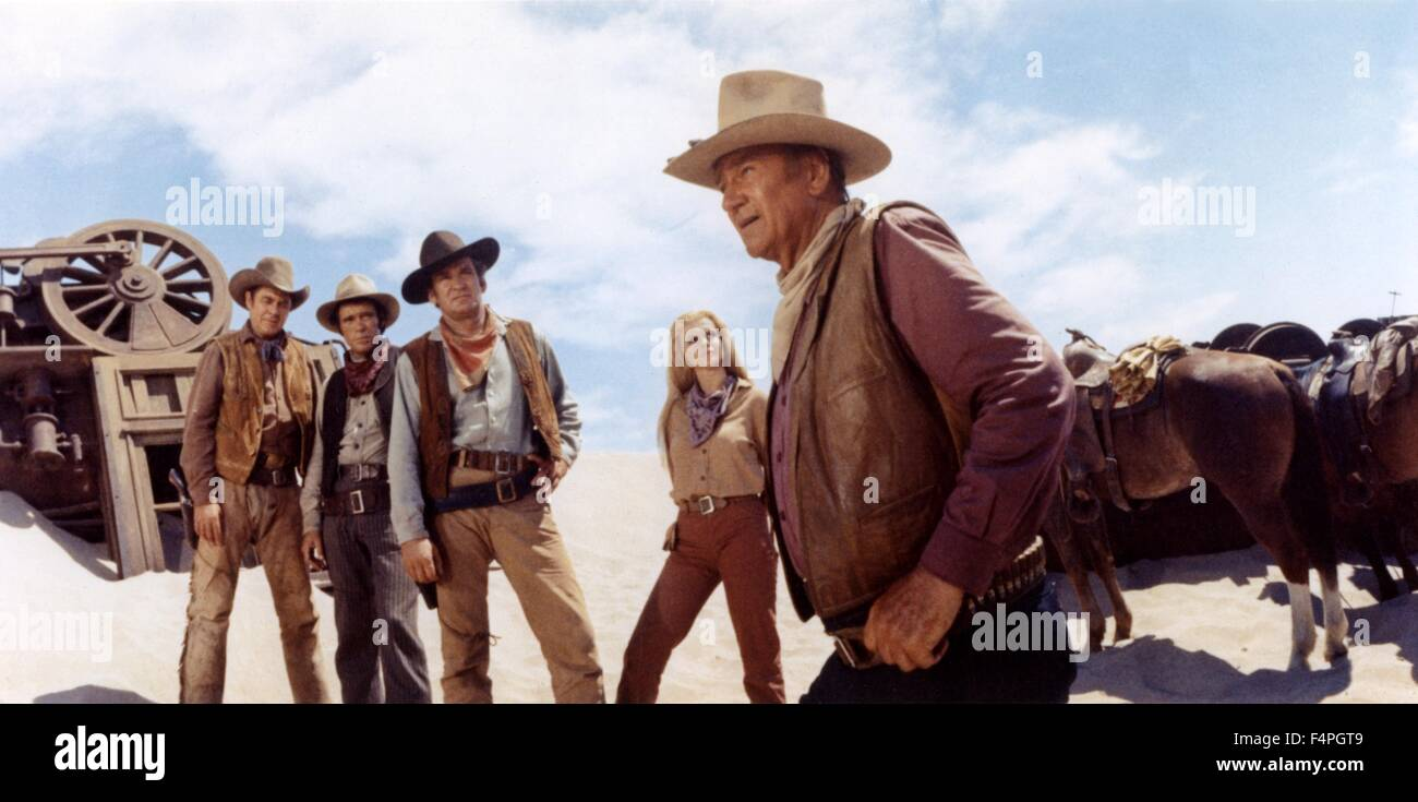 Ben Johnson, Christopher George, Rod Taylor, Ann-Margret and John Wayne / The Train Robbers / 1973 directed by Burt Stock Photo