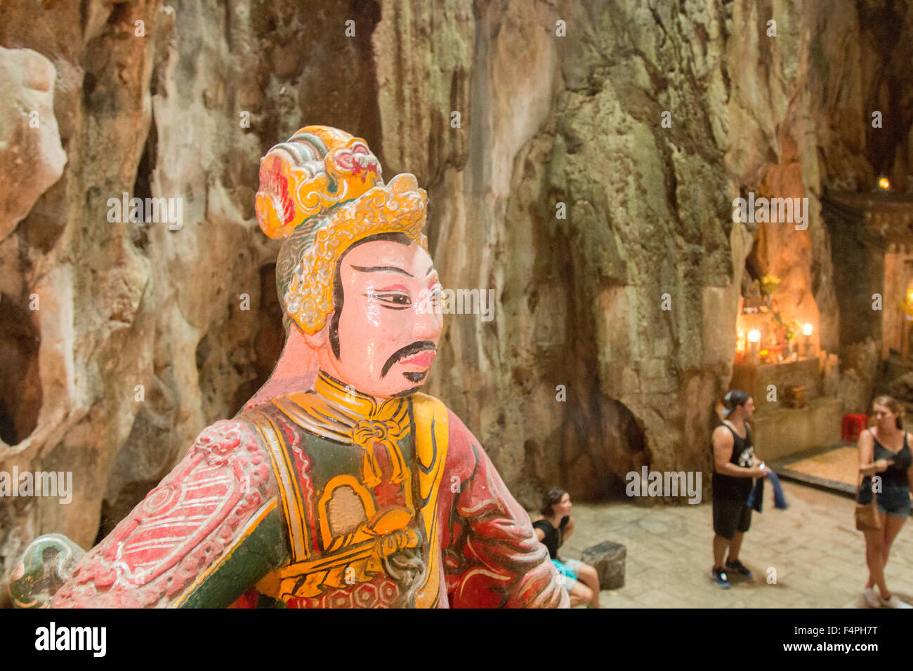 Huyen Khong cave on Thuy Son marble mountain with painted sculpture and tourist visitors,Da Nang,Vietnam - Stock Image