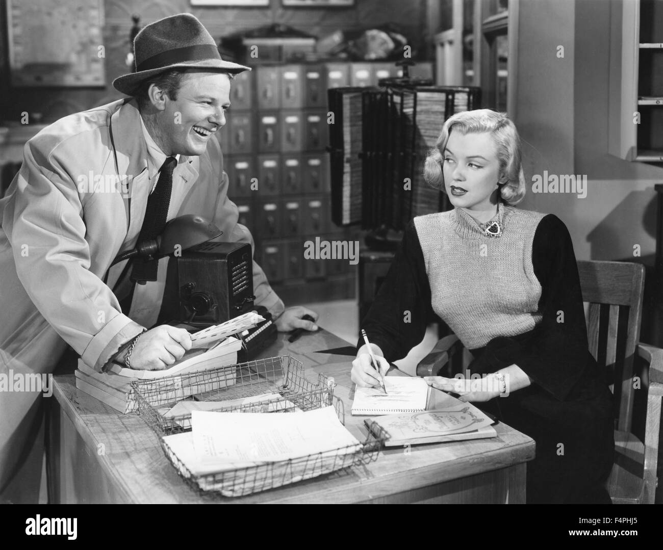 Alan Hale Jr. and Marilyn Monroe / Home Town Story / 1951 directed by Arthur Pierson [Metro-Goldwyn-Mayer Pictures] - Stock Image