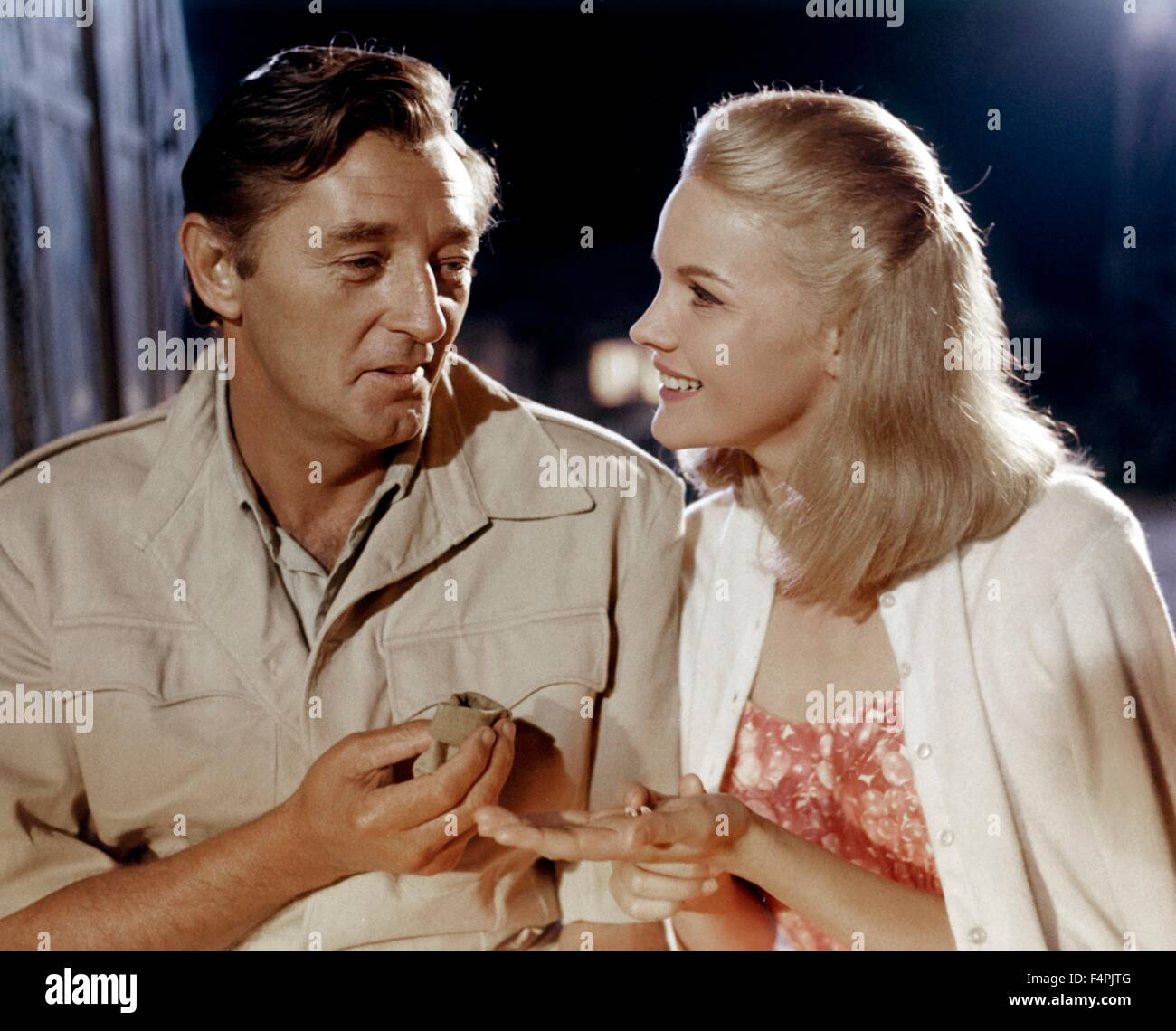 Robert Mitchum and Carroll Baker / Mister Moses / 1965 directed by Ronald Neame [United Artists] - Stock Image