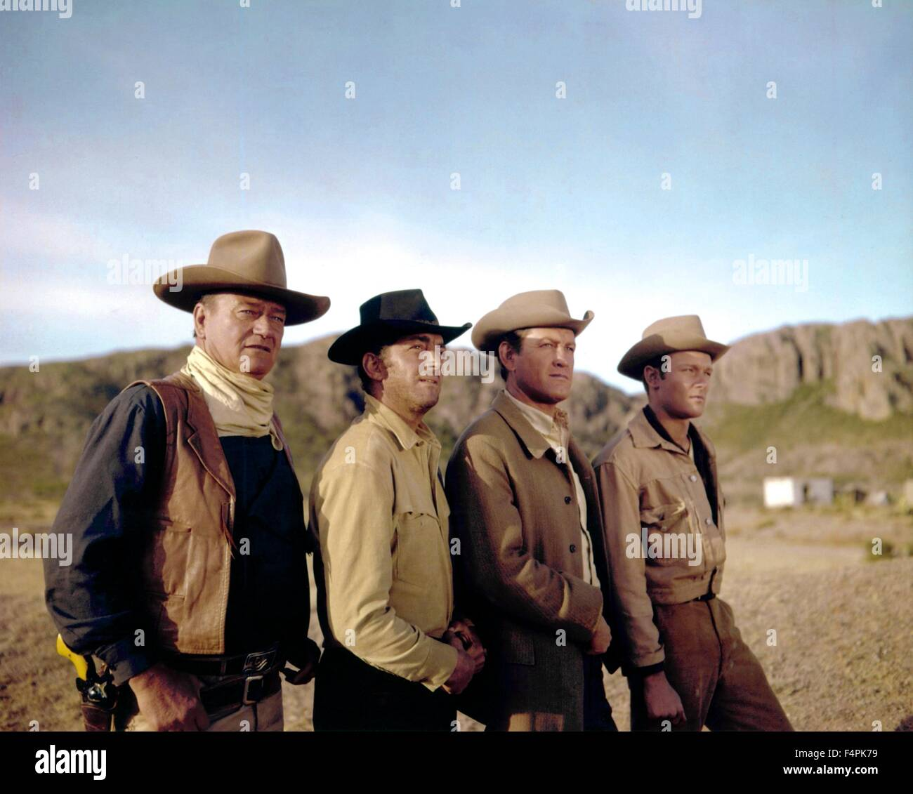John Wayne, Dean Martin, Earl Holliman and Michael Anderson Jr. / The Sons of Katie Elder / 1965 directed by Henry - Stock Image