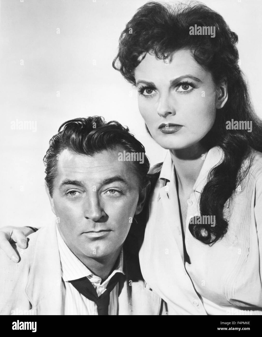 Robert Mitchum and Ursula Thiess / Bandido / 1956 directed by Richard Fleischer [United Artists] - Stock Image