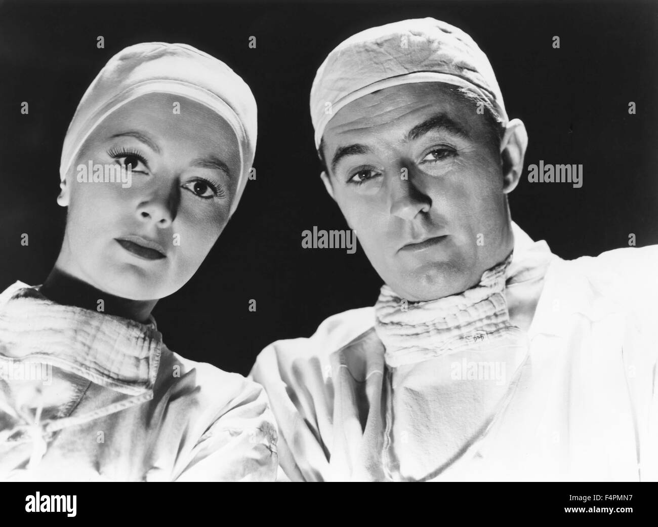 Olivia de Havilland and Robert Mitchum / Not as a Stranger / 1955 directed by Stanley Kramer [United Artists] - Stock Image