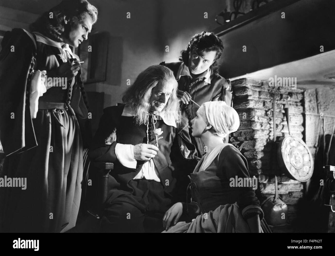 Jean Marais, Marcel Andre, Michel Auclair and Josette Day / Beauty and the Beast / 1946 directed by Jean Cocteau - Stock Image