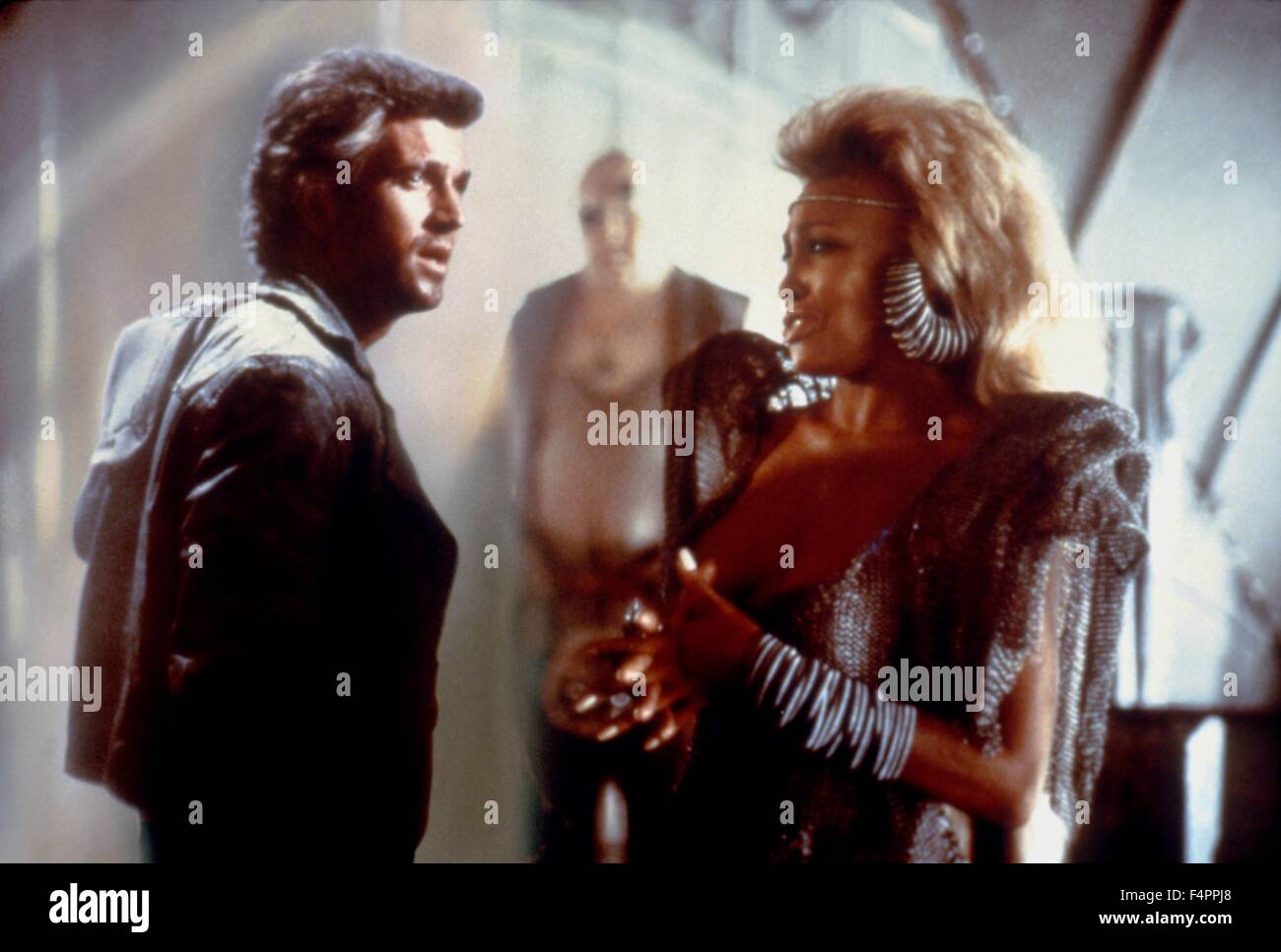 Mel Gibson and Tina Turner / Mad Max Beyond Thunderdome / 1985 directed by George Miller and George Ogilvie [Warner - Stock Image