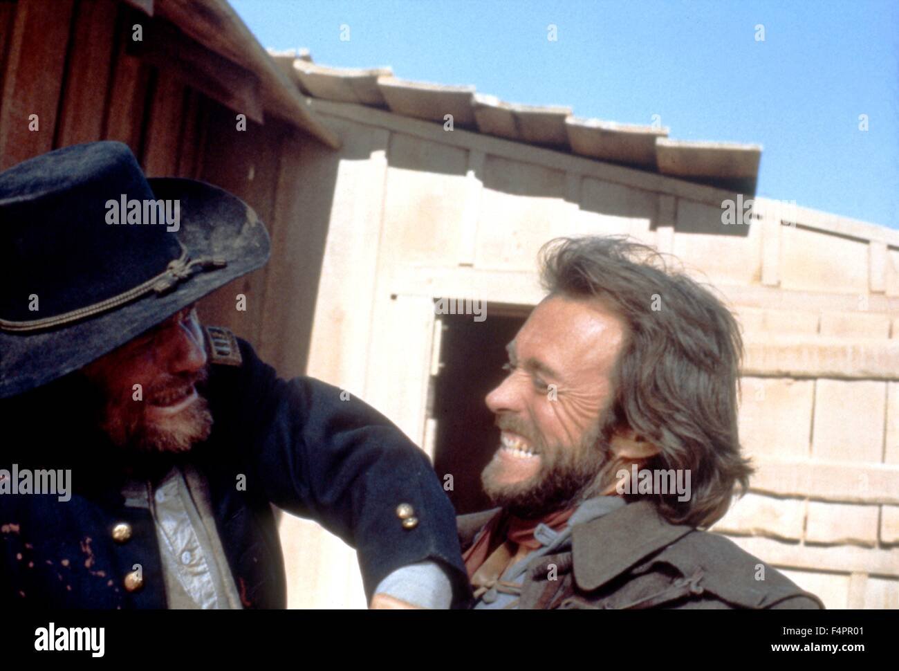 Bill McKinney and Clint Eastwood / The Outlaw Josey Wales / 1976 directed by Clint Eastwood  [Warner Bros. Pictures] - Stock Image