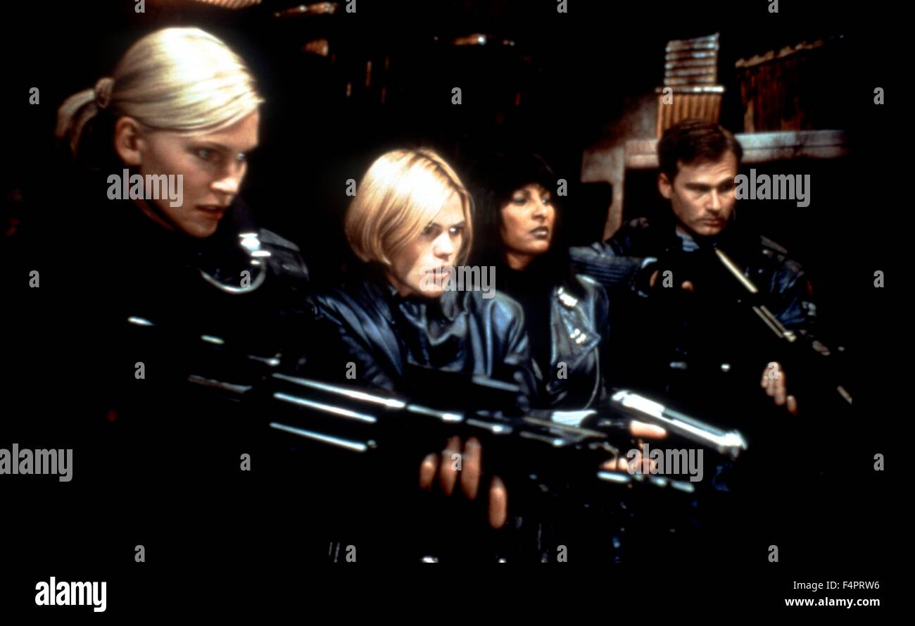 Natasha Henstridge, Clea DuVall and Pam Grier / Ghosts Of Mars / 2001 directed by John Carpenter  [Screen Gems / - Stock Image