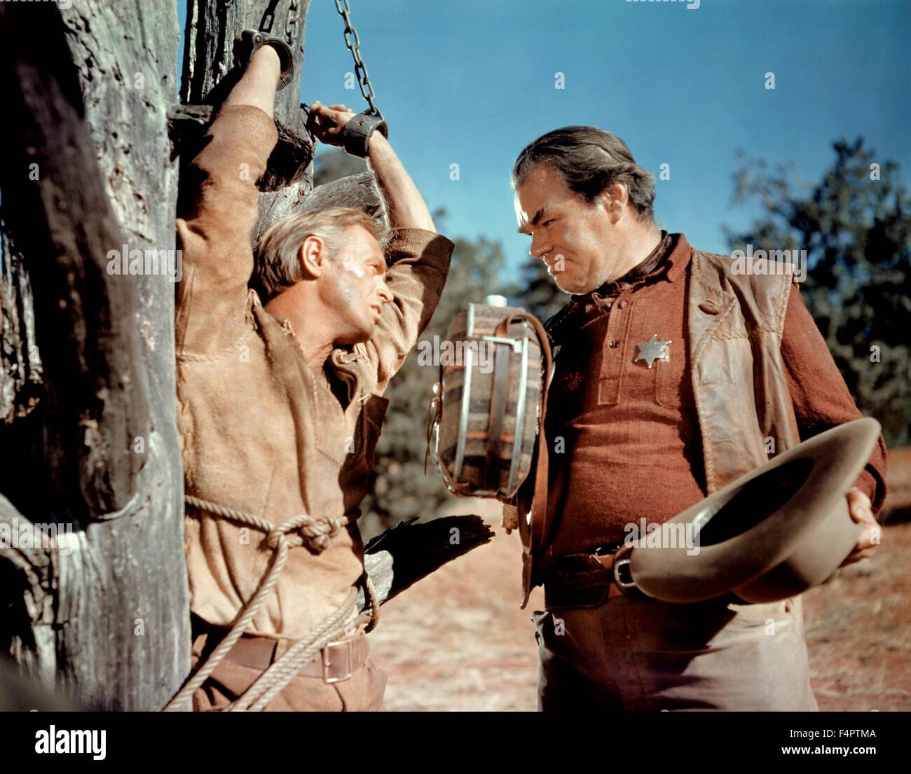 Richard Widmark and George Matthews / The Last Wagon / 1956 directed by Delmer Daves [Twentieth Century Fox Film - Stock Image