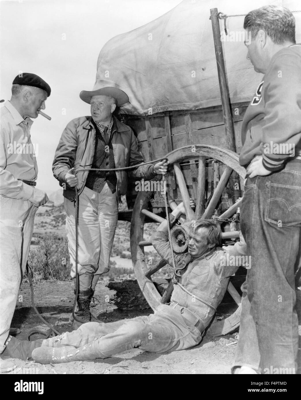 On the set, Delmer Daves (left) and Richard Widmark / The Last Wagon / 1956 directed by Delmer Daves [Twentieth - Stock Image