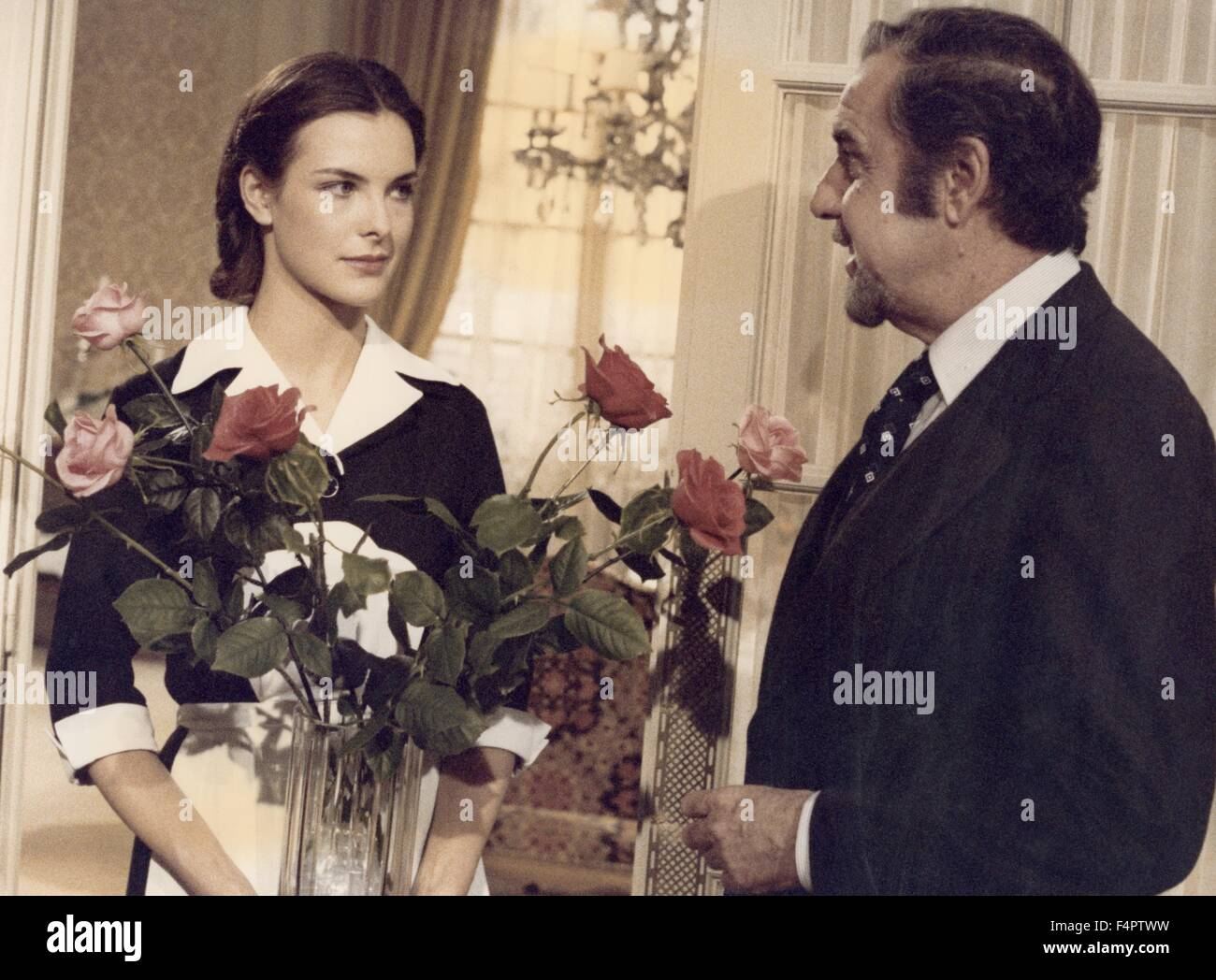 Carole Bouquet and Fernando Rey / That Obscure Object of Desire / 1977 directed by Luis Bunuel  [Greenwich Film - Stock Image