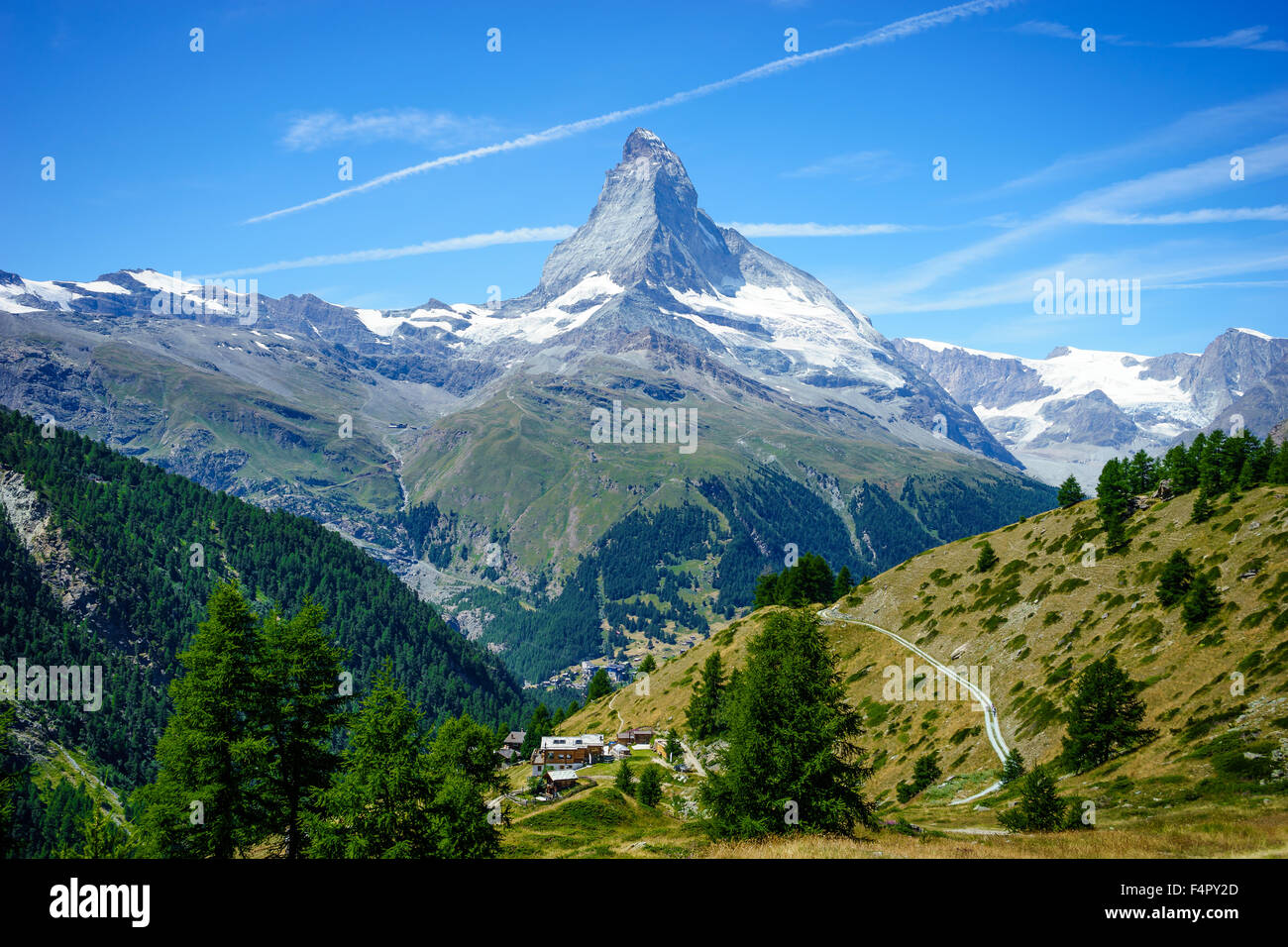 Hiking trails zig-zag through to Matterhorn peak. July, 2015. Matterhorn, Switzerland. - Stock Image