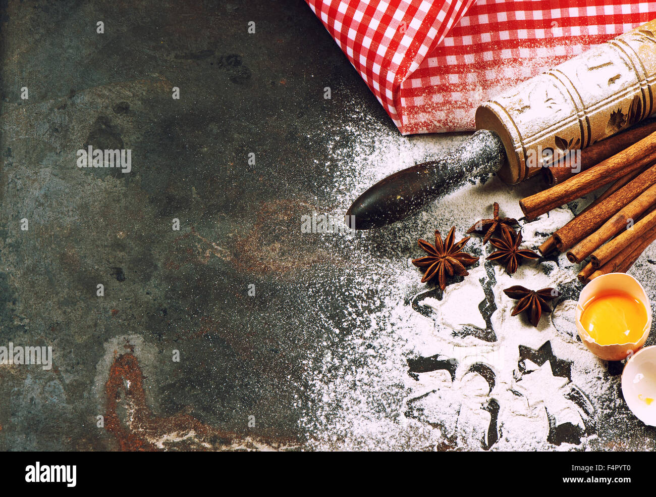 Baking ingredients and tolls for dough preparation. Christmas food. Vintage style toned picture - Stock Image