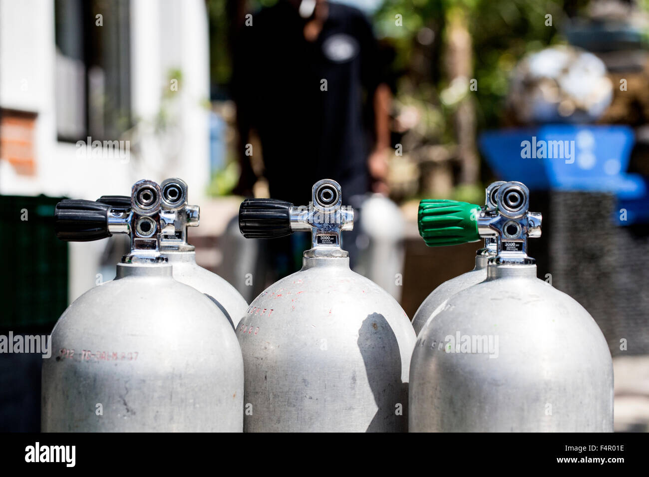 Scuba Tanks in the Sun at Dive Shop - Stock Image