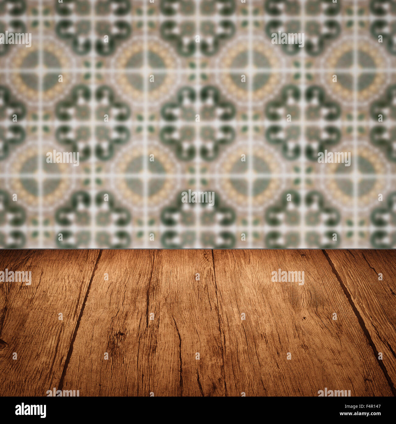 Empty wood table top and blur vintage ceramic tile pattern wall in empty wood table top and blur vintage ceramic tile pattern wall in background mock up template for display of your product maxwellsz