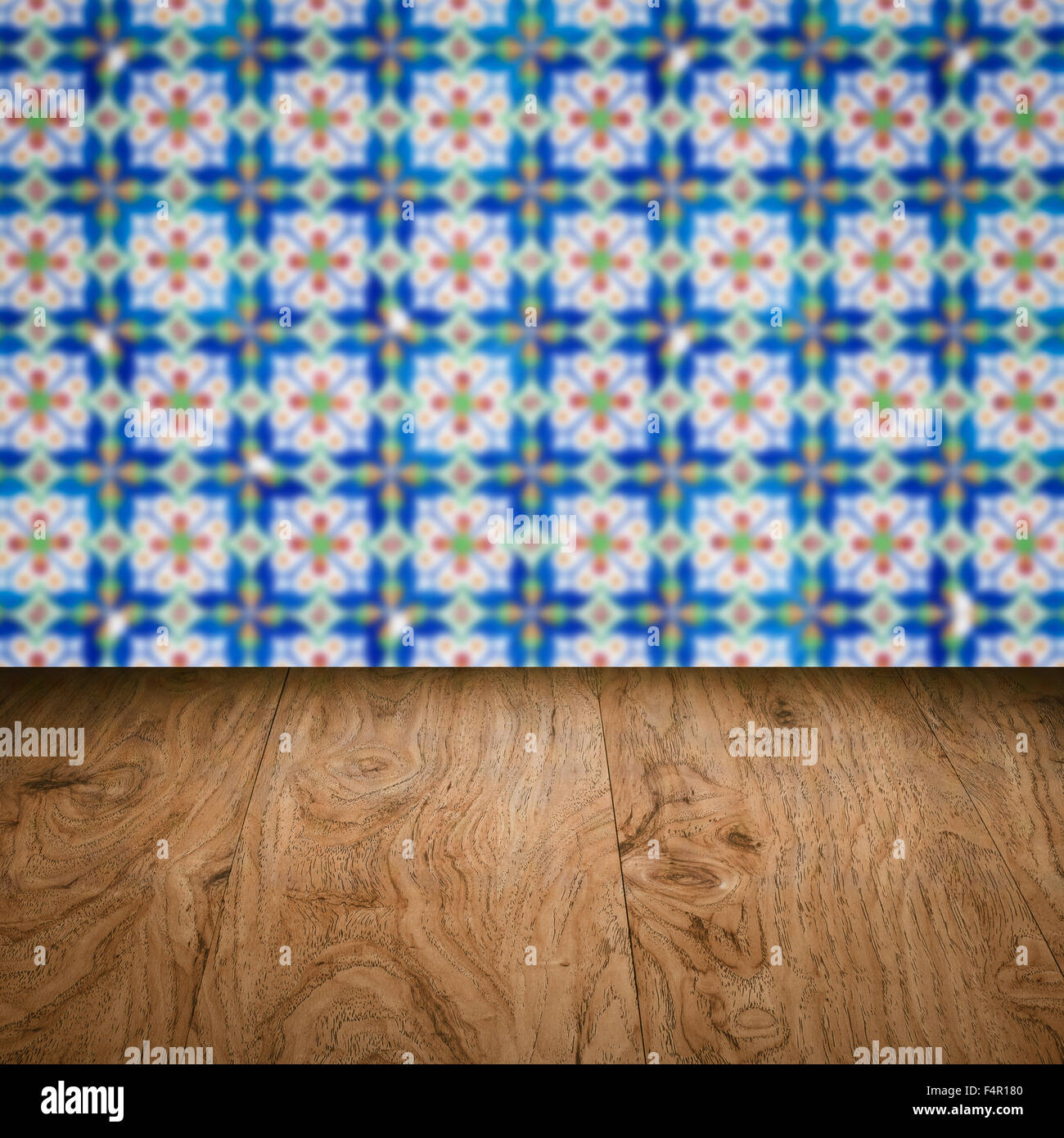 Empty wood table top and blur vintage ceramic tile pattern wall in ...