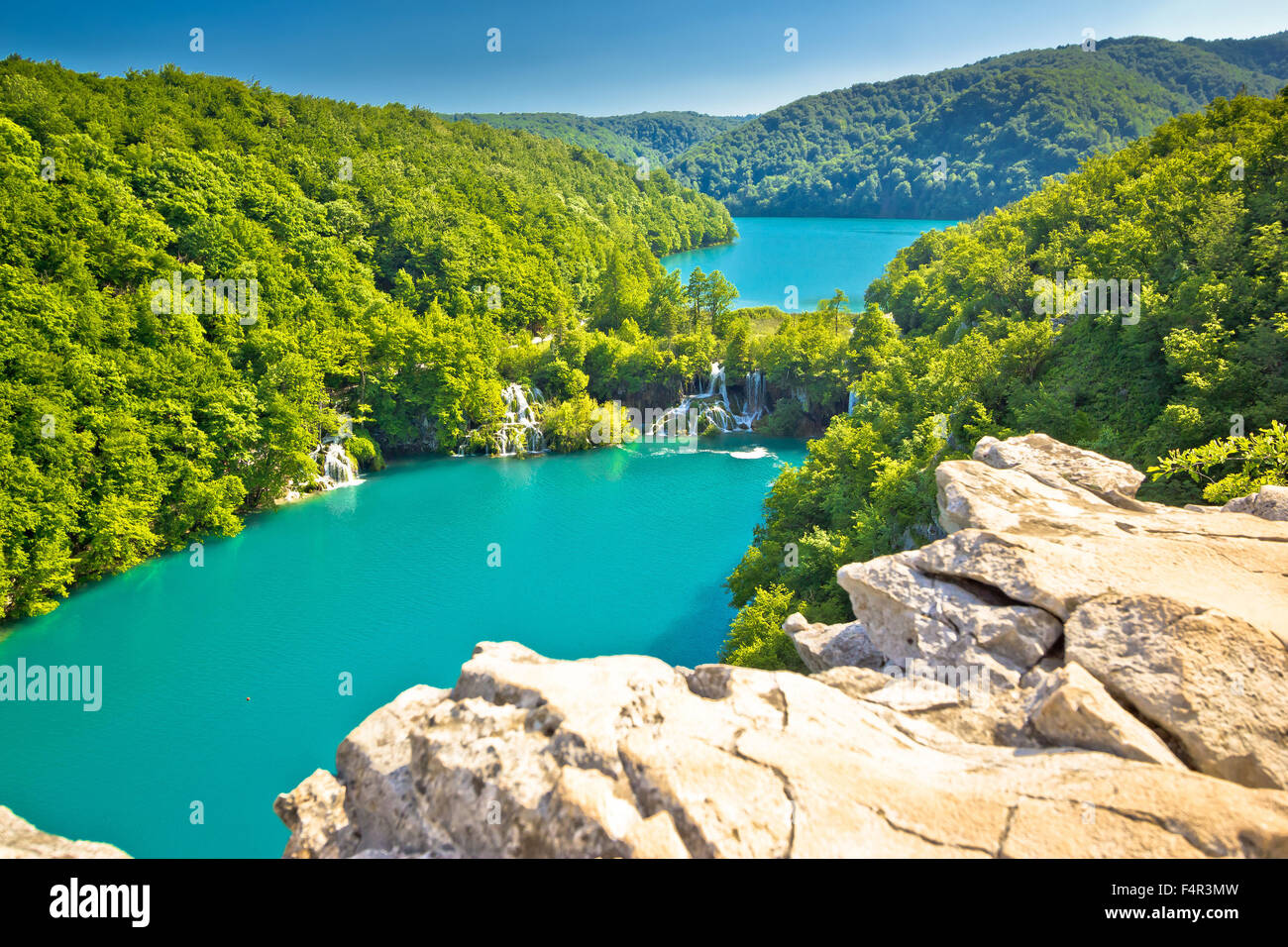 Turquoise water of Plitvice lakes national park in Croatia - Stock Image