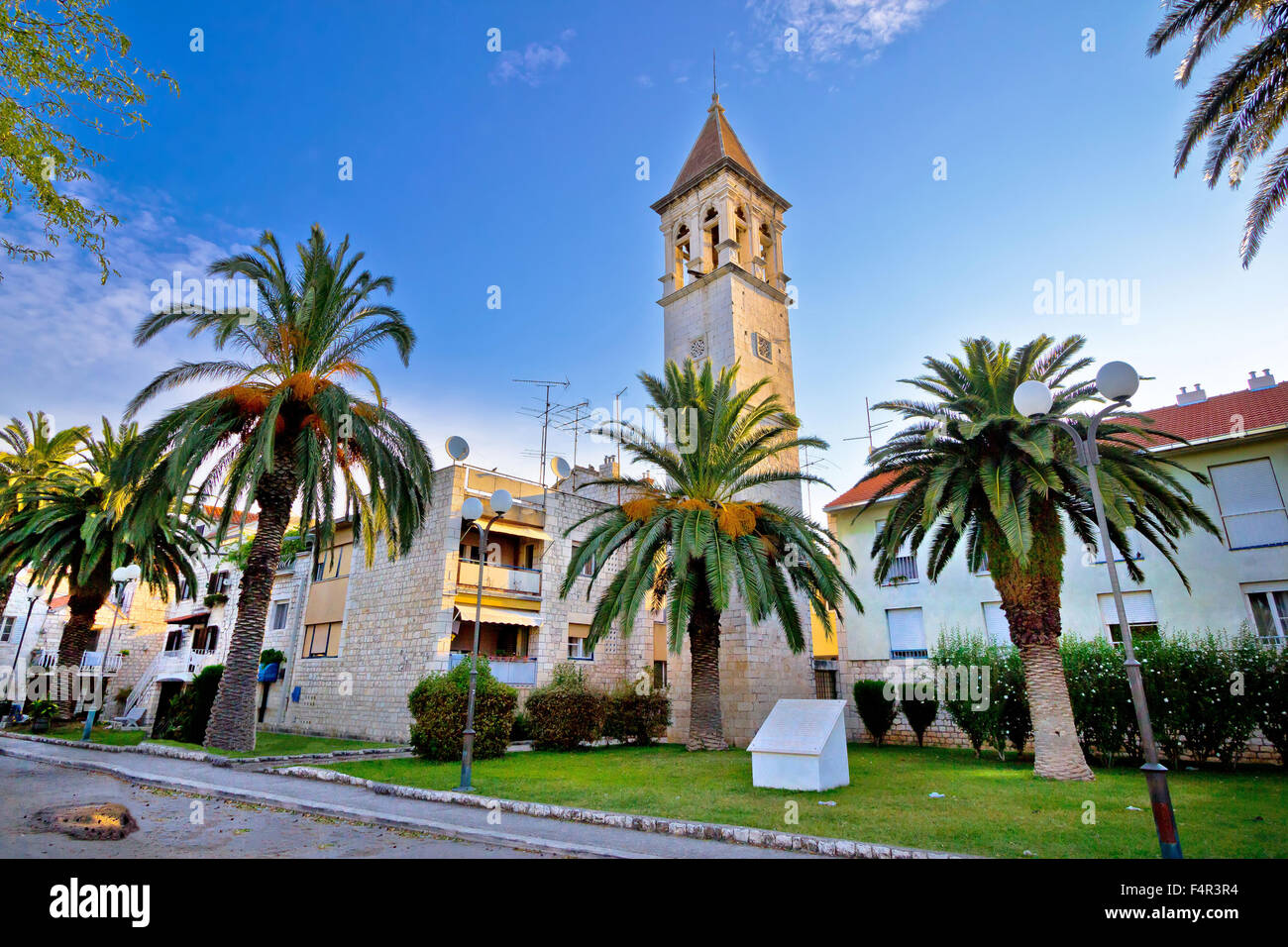Teogir stone church and palms view, UNESCO site in Croatia - Stock Image
