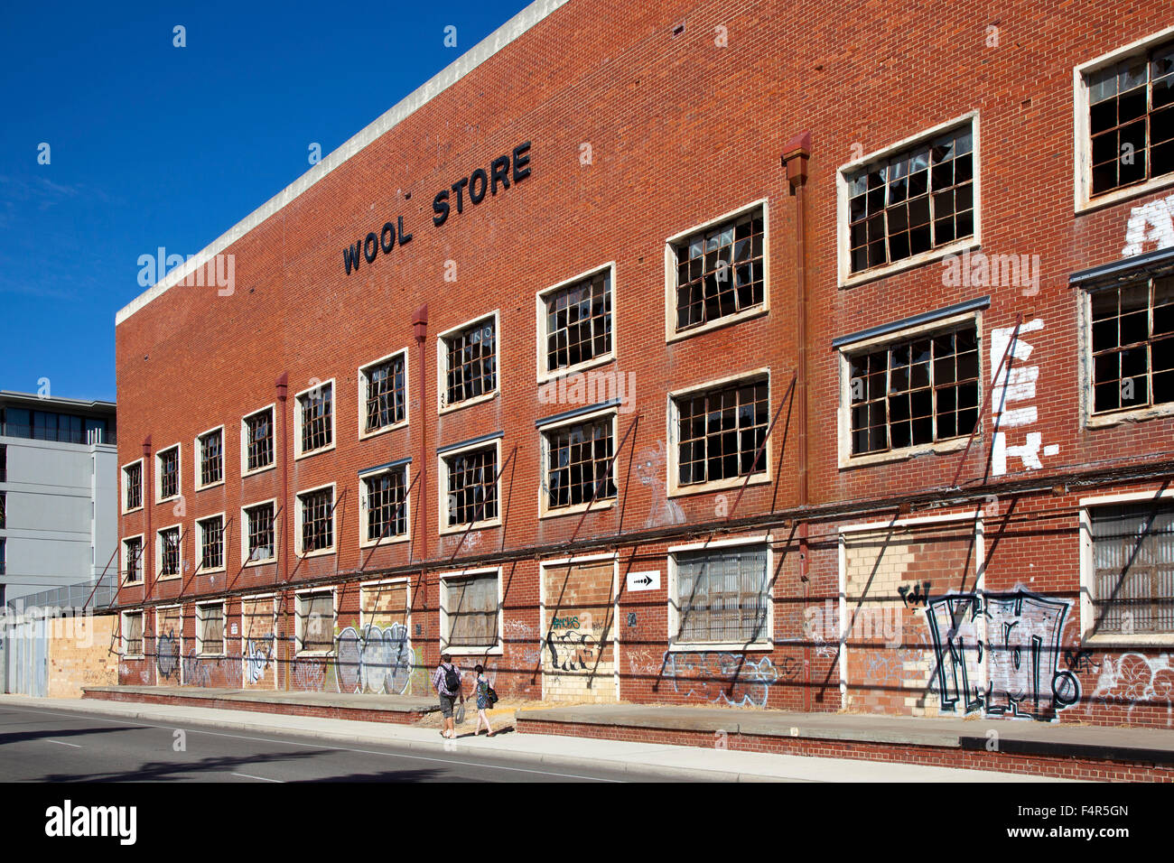 Australia, Fremantle, street, derelict building, old, wool store, frontage, bricked up, broken windows, red brick, - Stock Image