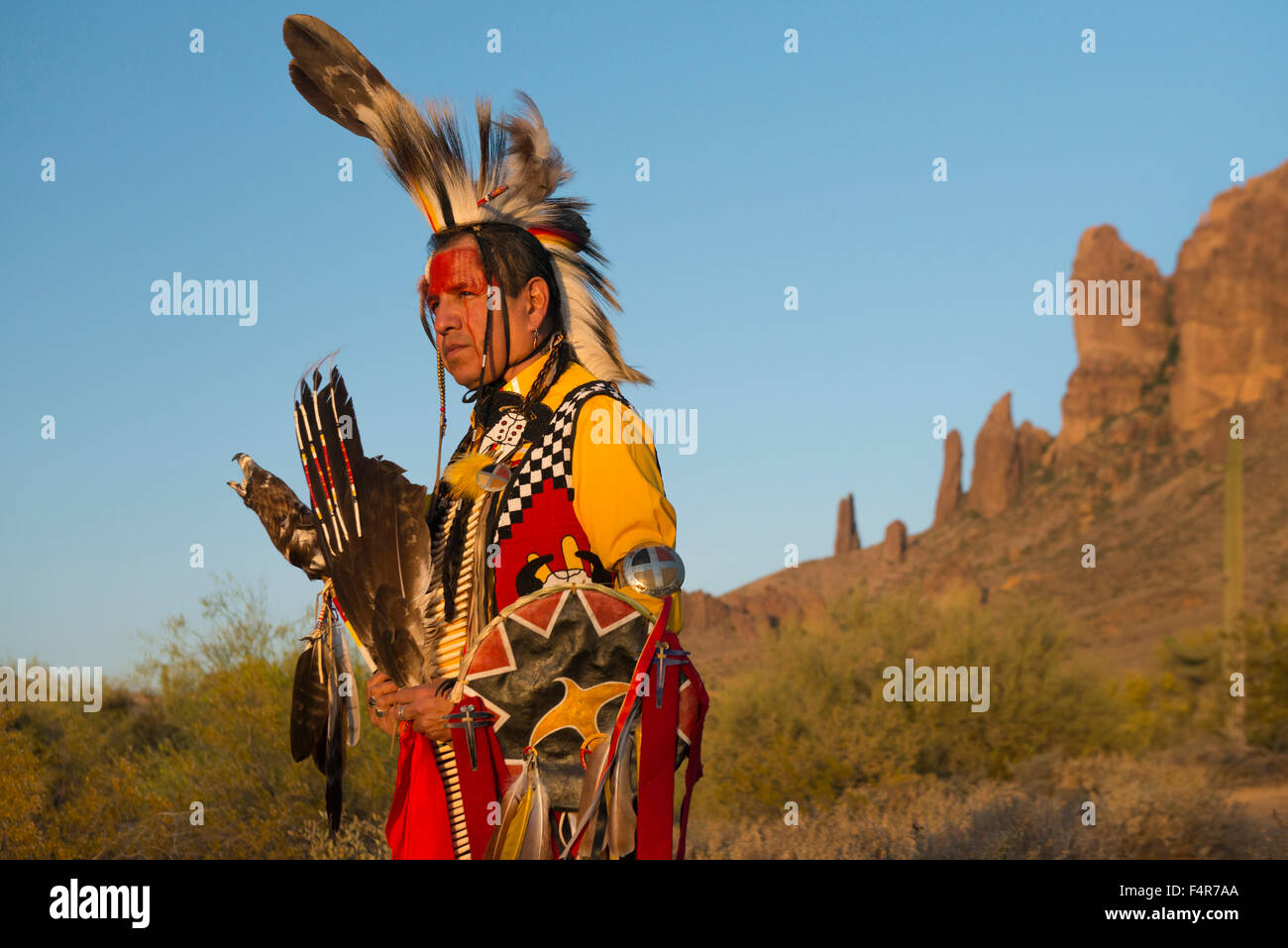 USA, United States, America, Arizona, Desert Southwest, Indian, regalia, warrior, man, cliffs, portrait, Jim Yellowhawk, - Stock Image