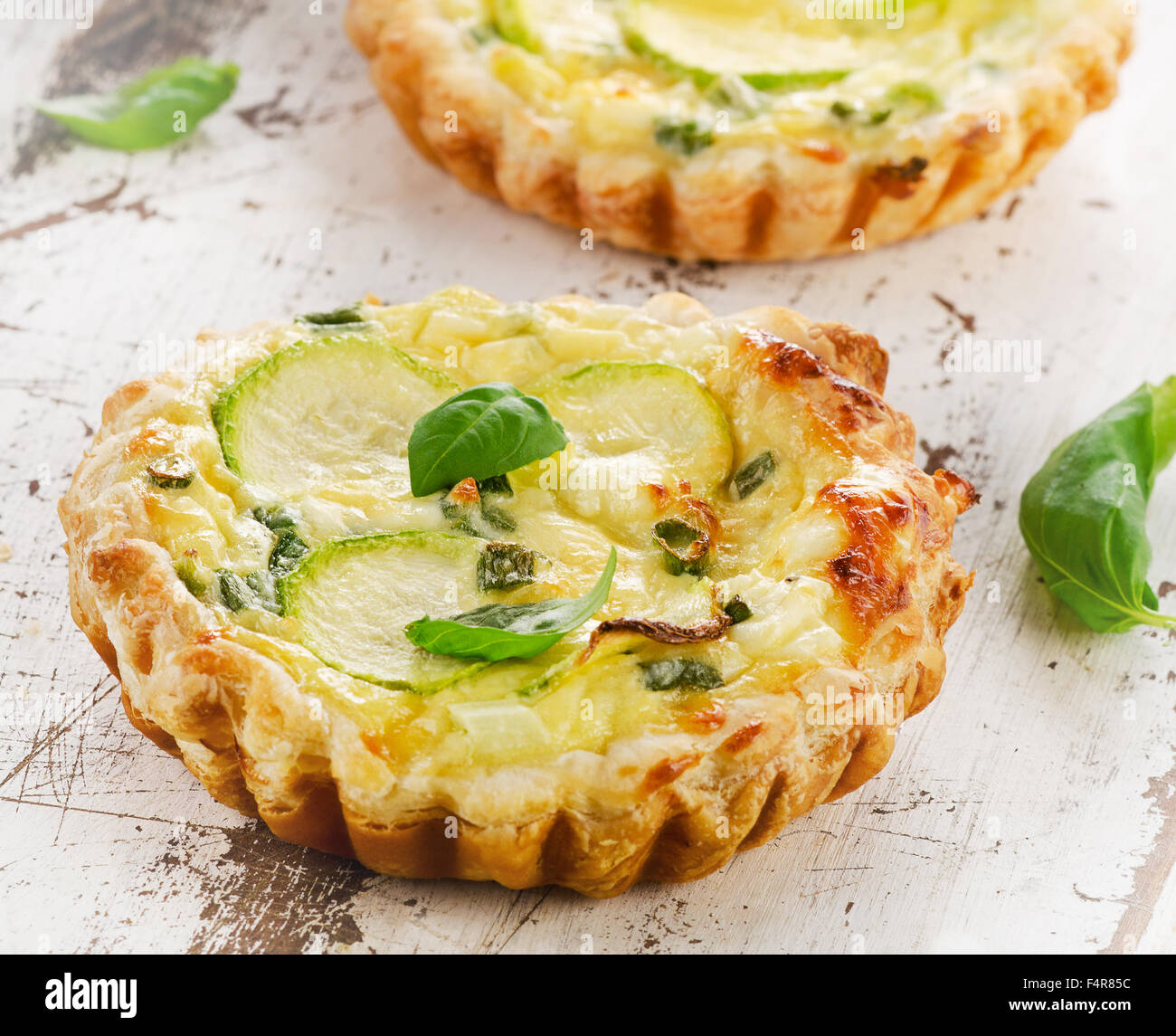 Tart with cheese on wooden table. Selective focus - Stock Image