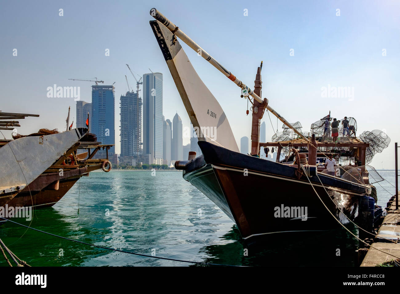 Traditional wooden dhow fishing boat in Abu Dhabi United Arab Emirates - Stock Image