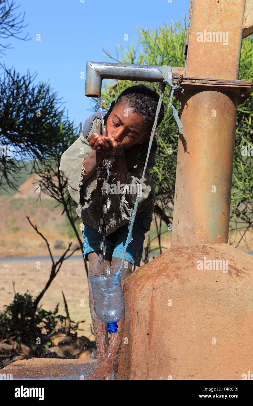 Amhara Region, child drinks water at the fountain Stock Photo