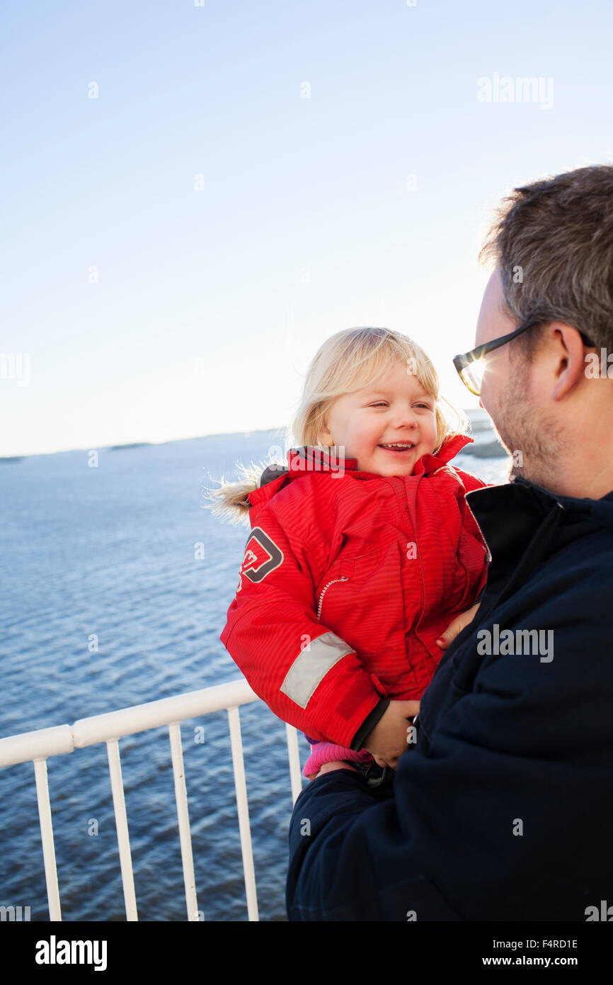 Sweden, Bohuslan, Gothenburg, Father and daughter (2-3) on ship - Stock Image