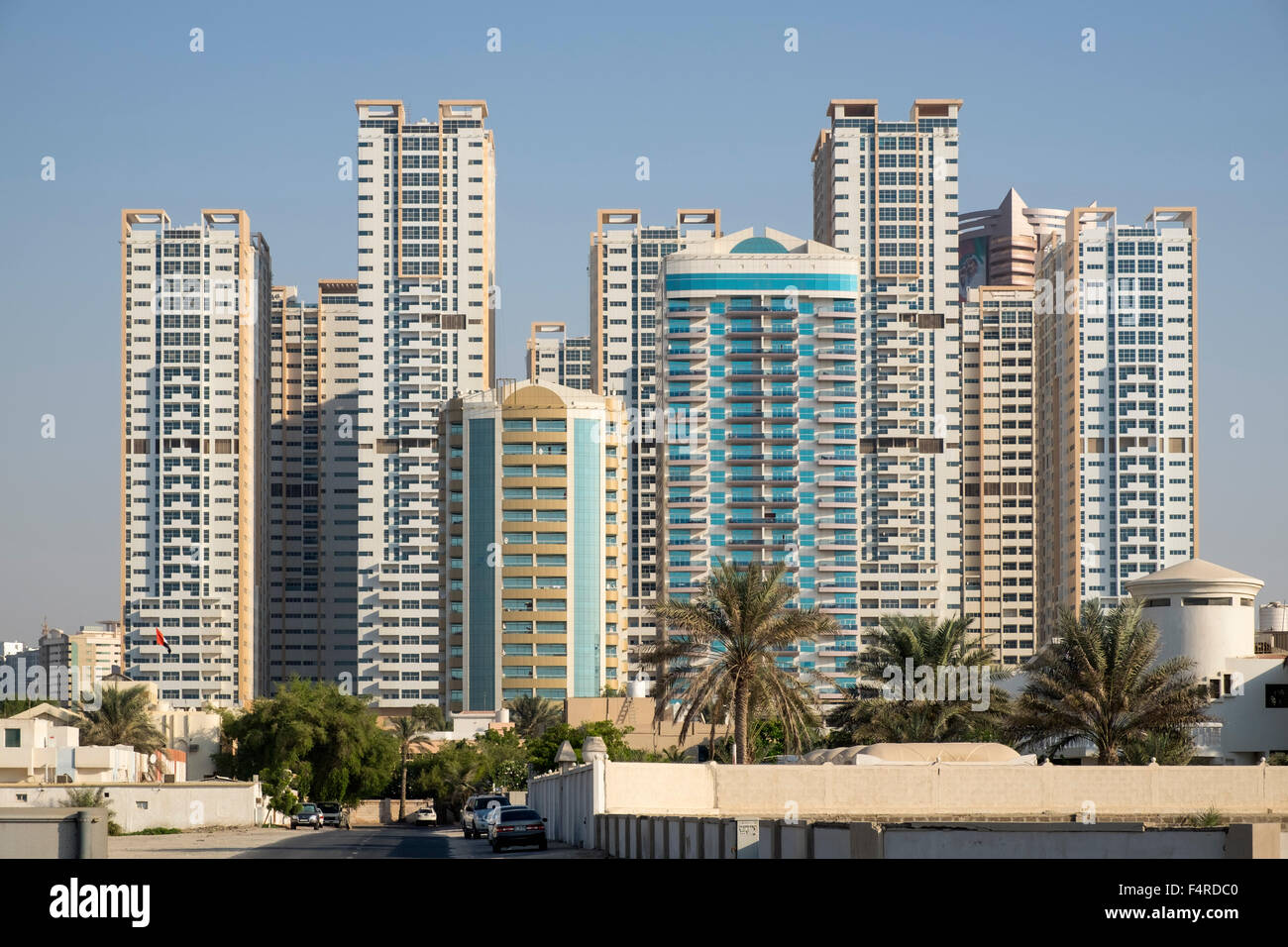 View of modern high-rise residential apartment blocks in Ajman Emirate in United Arab Emirates - Stock Image