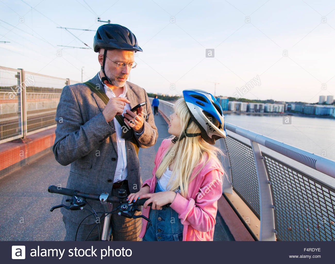 Sweden, Stockholm, Father and daughter (10-11) commuting - Stock Image