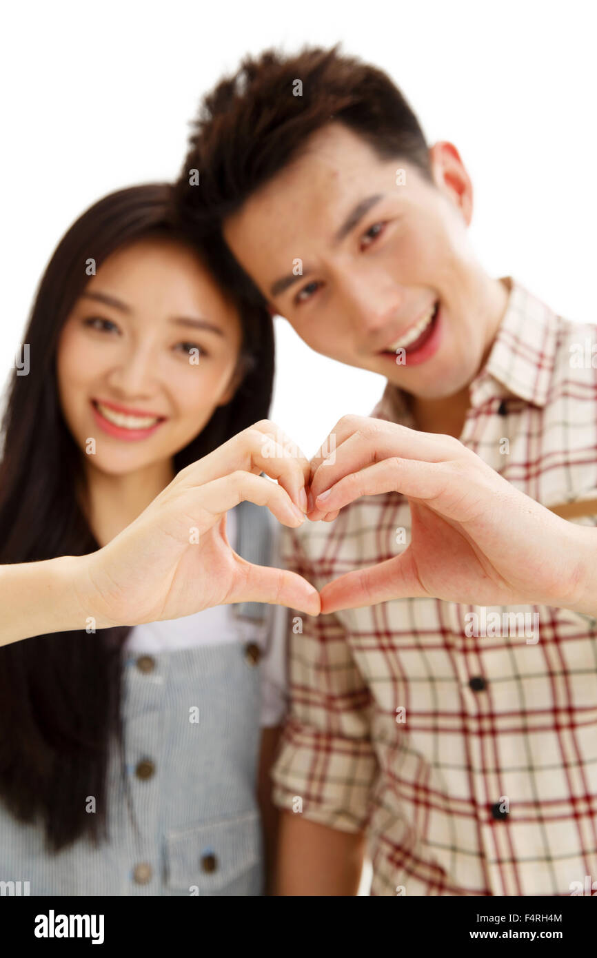 The young lovers do heart-shaped gestures - Stock Image