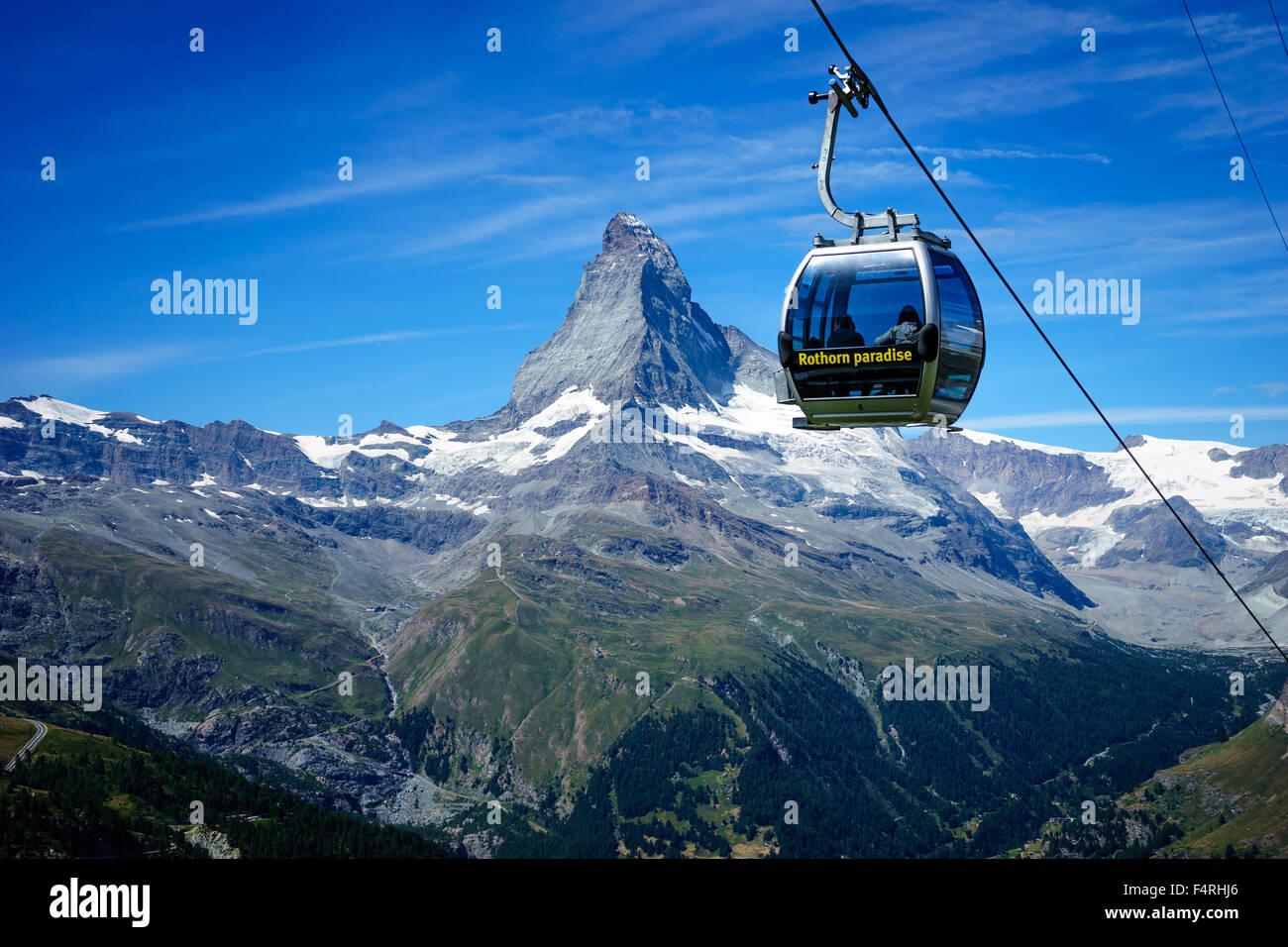 A cable car soars past Matterhorn peak. July, 2015. Matterhorn, Switzerland. Stock Photo
