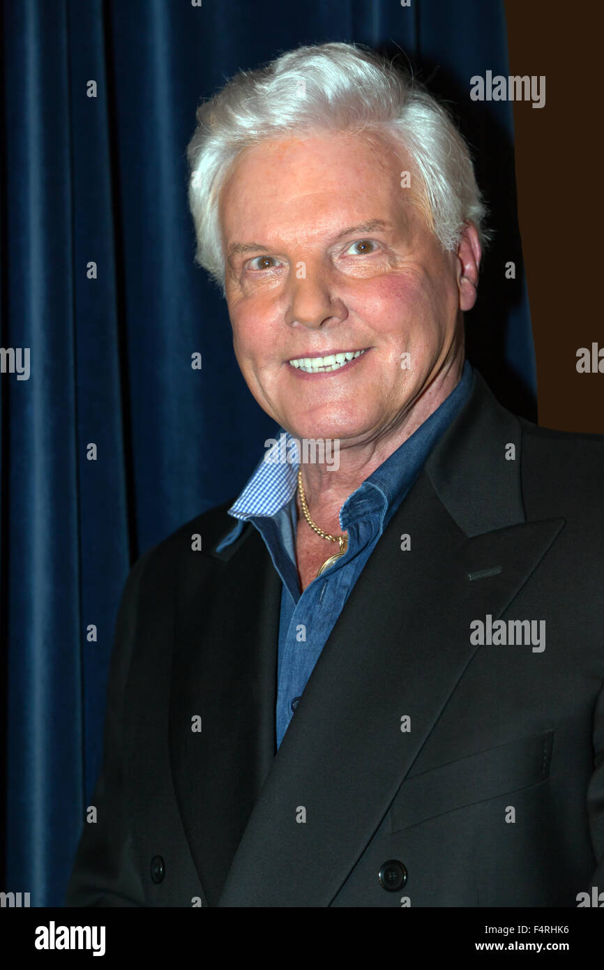Jess Conrad OBE, posing for a publicity picture at the Cinema Museum, Kennington. - Stock Image