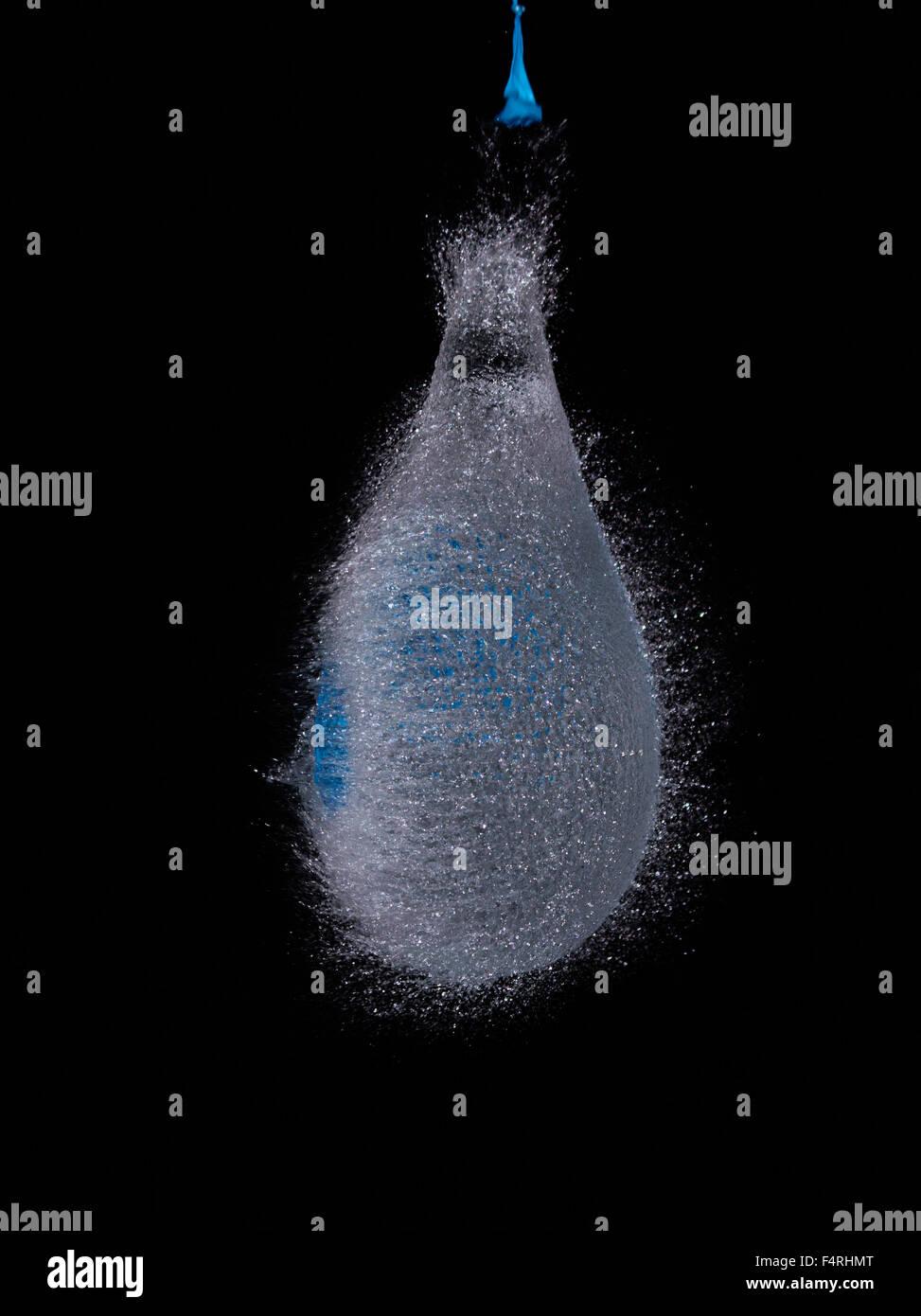 Water Bomb Bursting - Stock Image