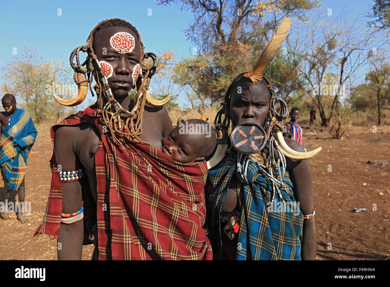 in Maco National Park, Mursi, Mursi Woman with Baby, painted skin and headdress, young Teller lip woman in the lip - Stock Image