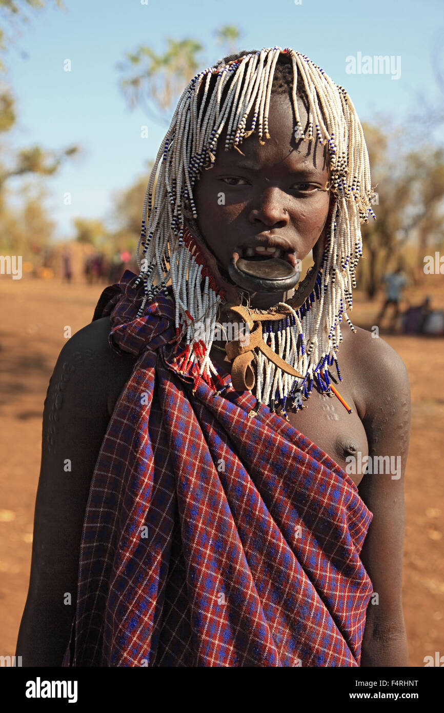 in Maco National Park, poeple of the Mursi, young Mursi woman lip plate woman woman with plate in the lower lip, - Stock Image