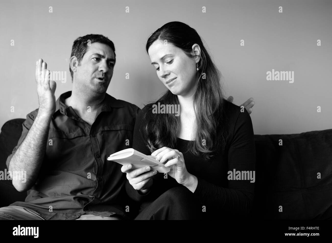 Couple disagree about expectation of life at home. (BW). Spouse relationship concept - Stock Image