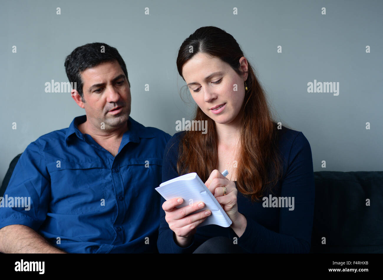 Couple planning their life the living room. Spouse relationship concept - Stock Image