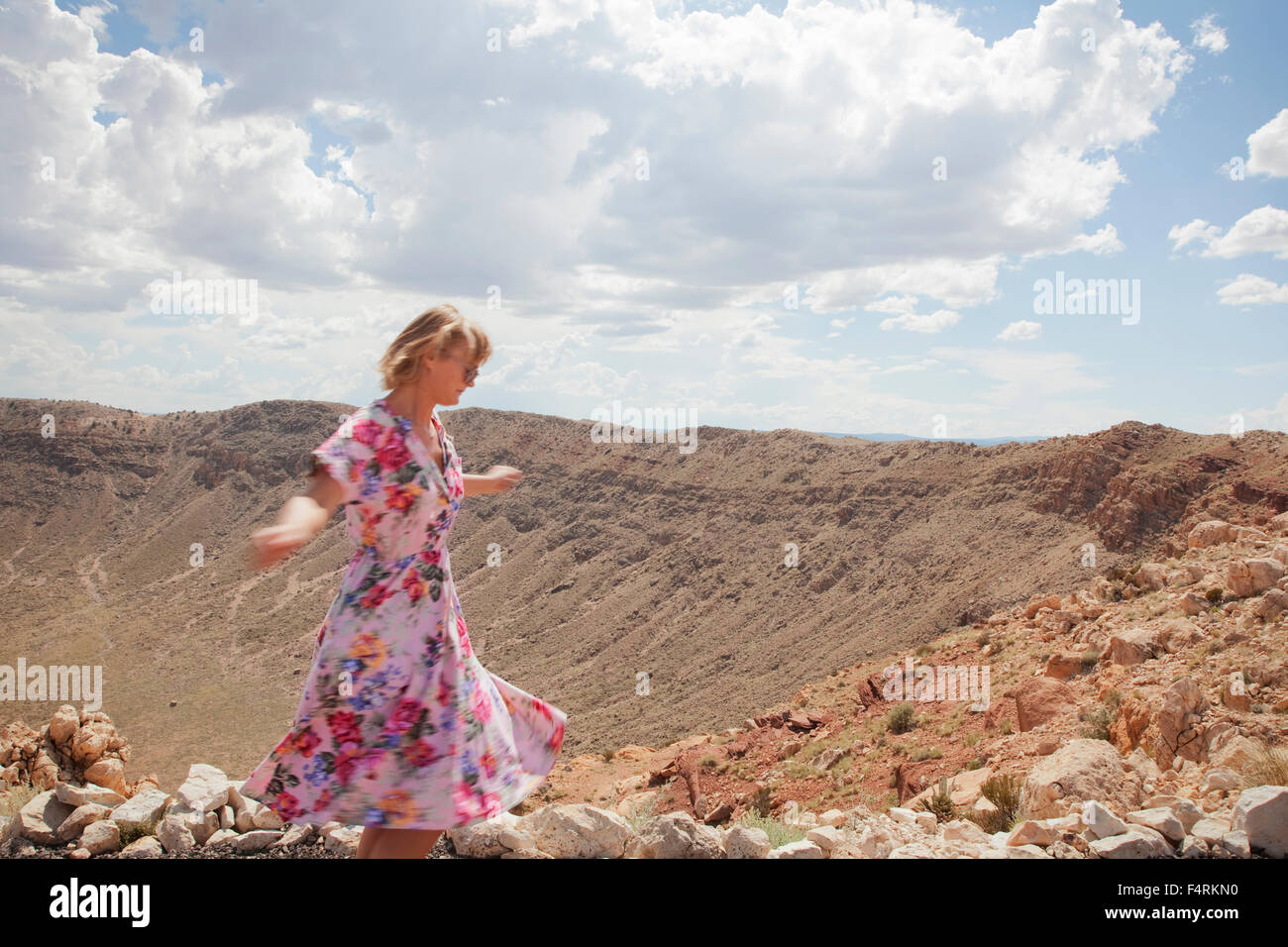 Woman exploring Barringer Crater, Arizona, USA - Stock Image