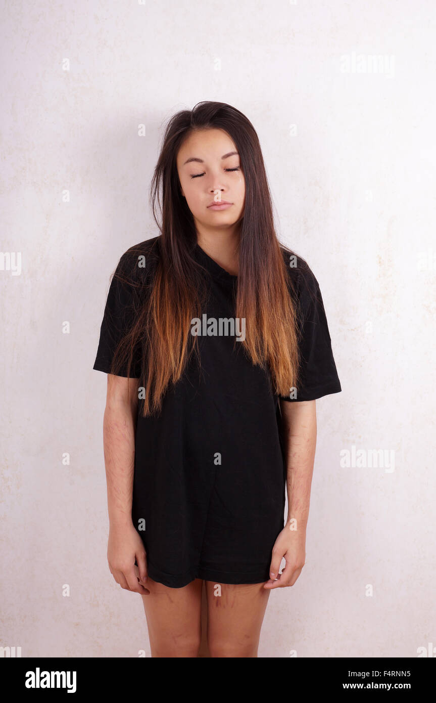 crying girl with self inflicted cuts Stock Photo