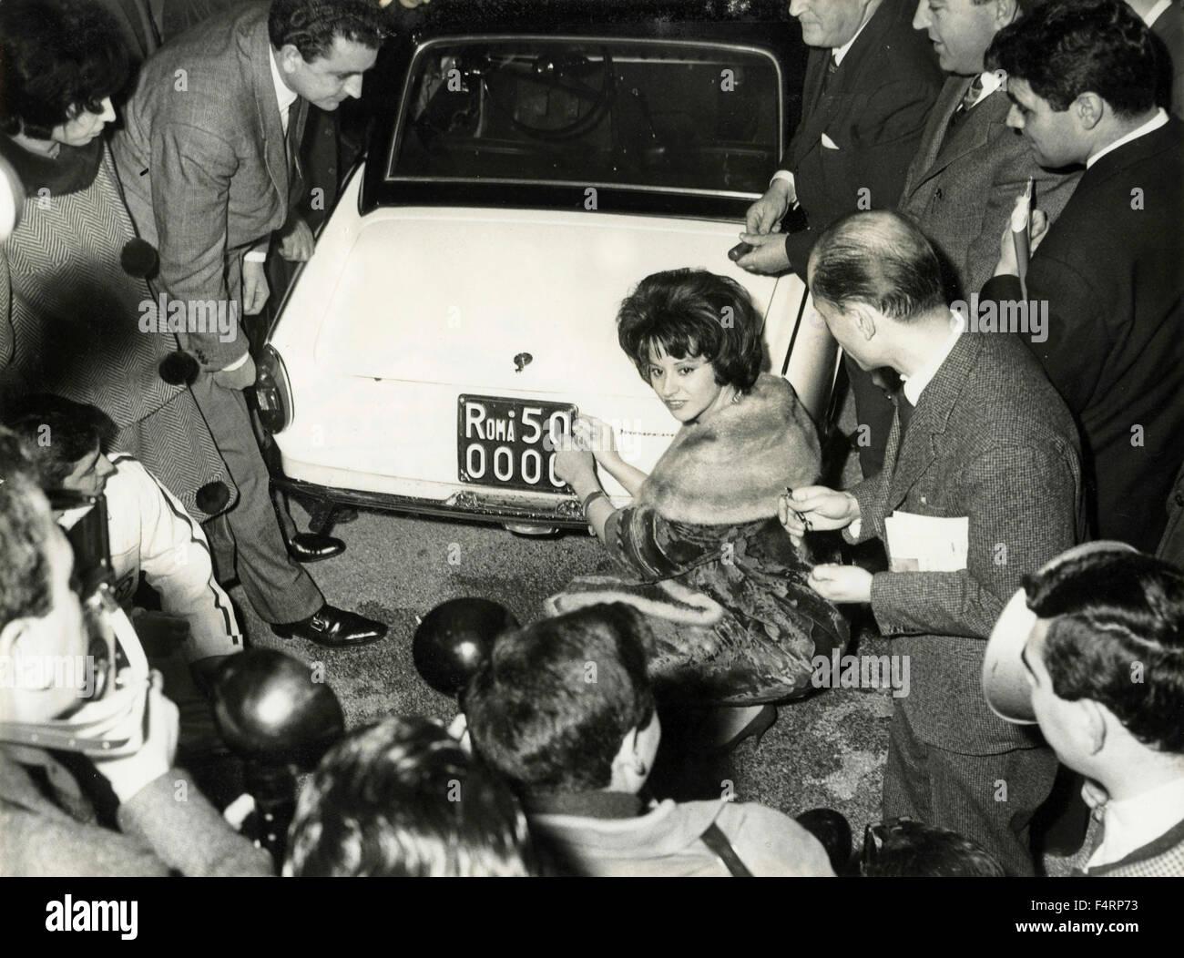 Italian actress Miranda Martino opened the car number plate 500000 Rome, ItalyStock Photo