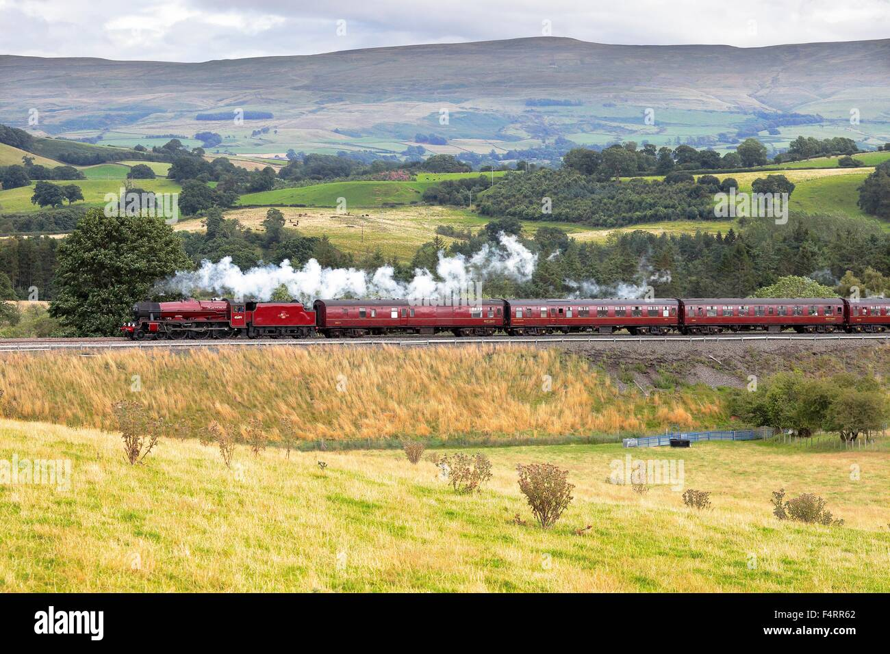 Steam locomotive LMS Jubilee Class 45699 Galatea on the Settle to Carlisle Railway Line near Lazonby, Eden Valley, - Stock Image
