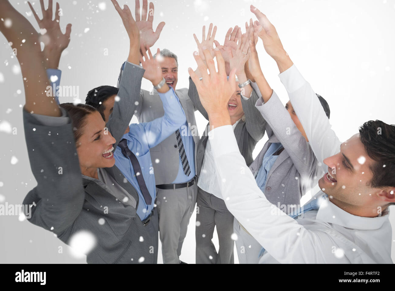 Composite image of business people raising their arms Stock Photo