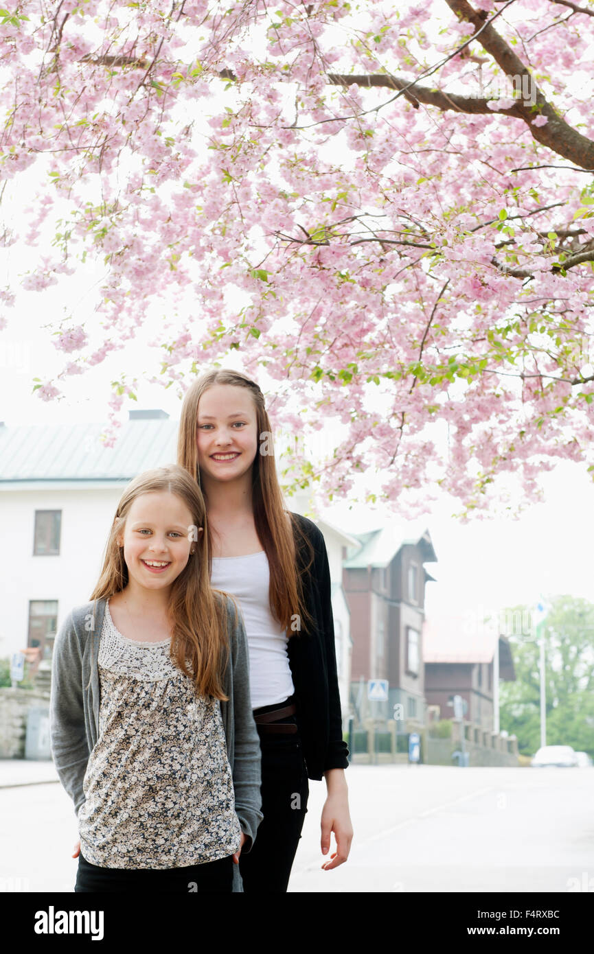 Portrait of girls (8-9, 14-15) in spring - Stock Image
