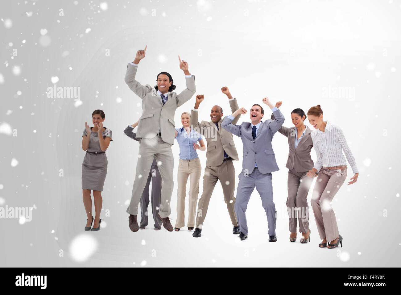 Composite image of very enthusiast business people jumping and raising their arms - Stock Image