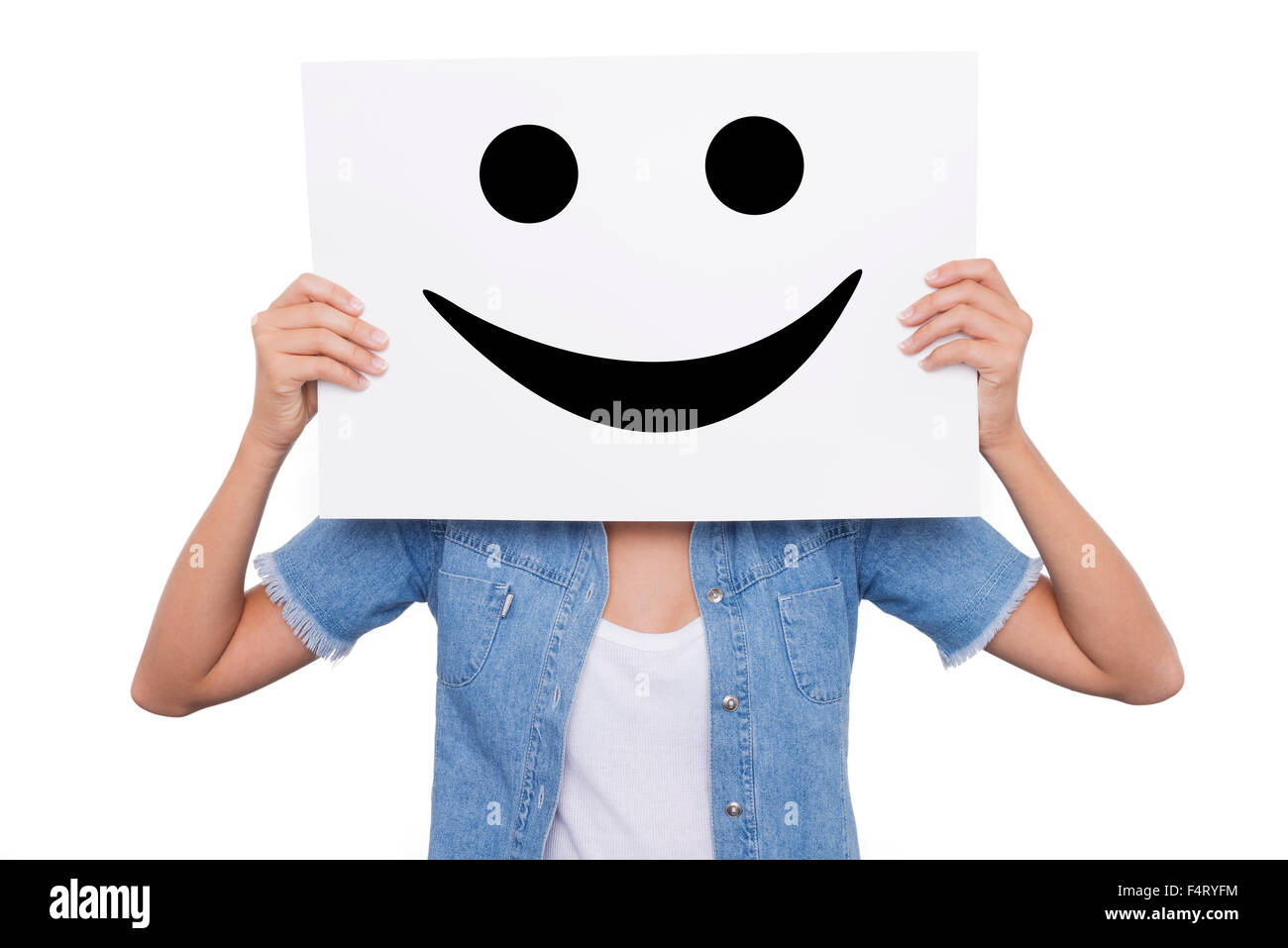 Blonde Girl holding a placard with a smiling smiles front of her face - Stock Image
