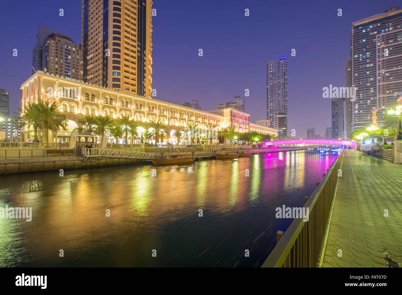 Evening viewof Al Qasba entertainment district in Sharjah United Arab Emirates - Stock Image