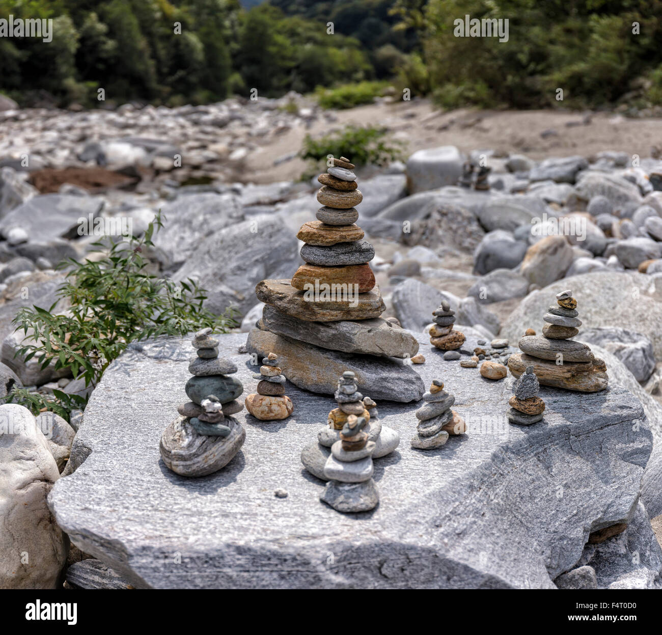 Switzerland, Europe, Tegna, Ticino, Pebble towers, cairn, maggia valley, landscape, water, summer, - Stock Image