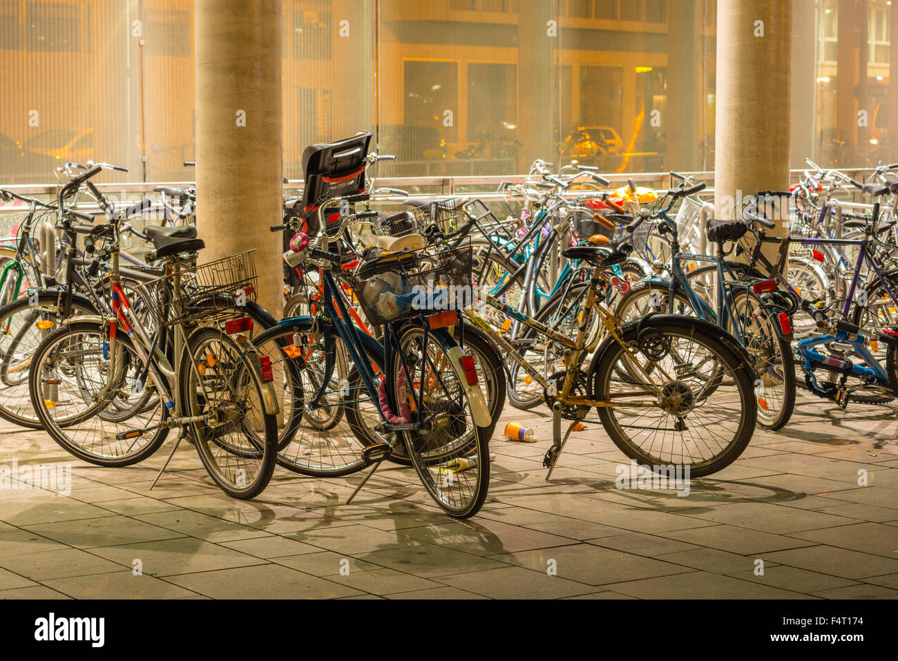 parked bicycles, lights, illumination, Breslau place, Germany, Europe, bicycle parking, bicycles, bikes, Cologne, - Stock Image