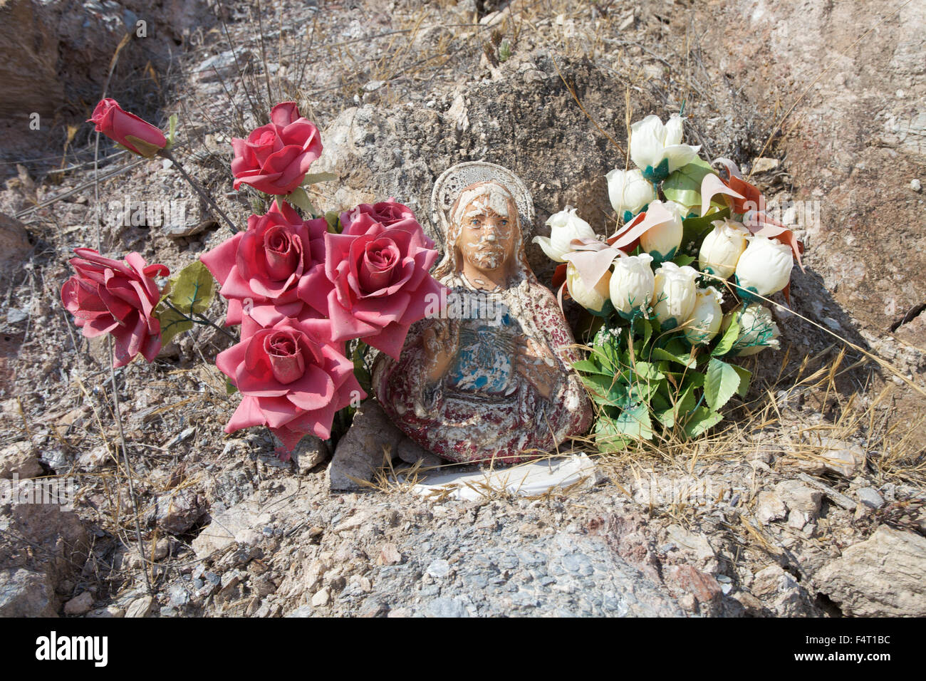 A religious shrine with flowers beside a road in Spain. Stock Photo